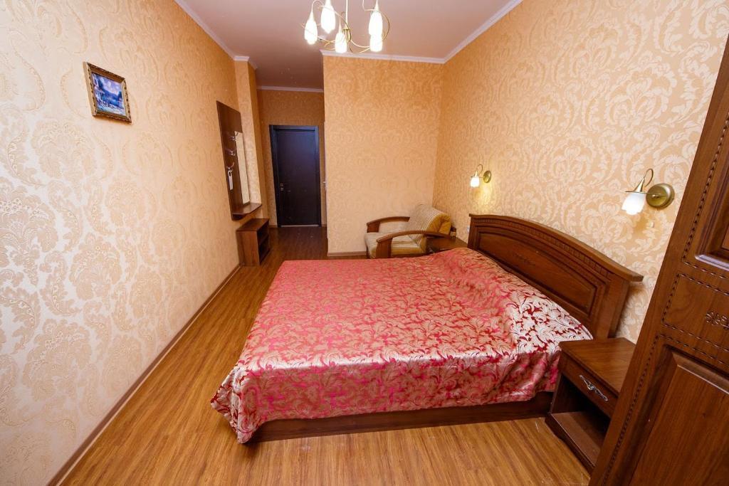 Кровать или кровати в номере Гостиница Прометей 2