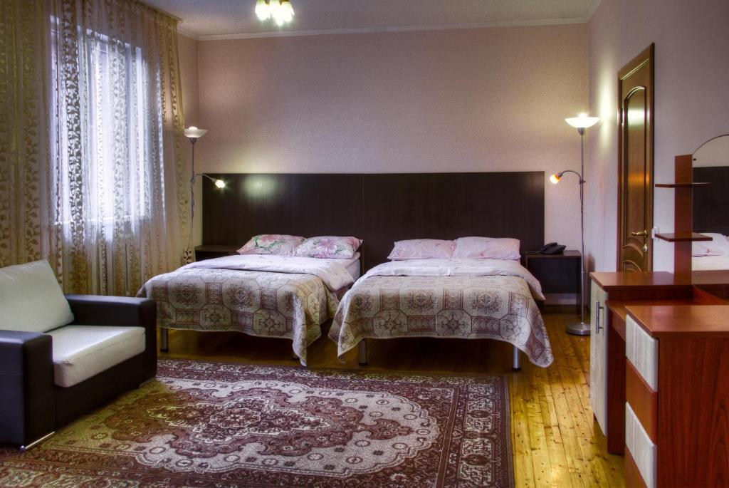 A bed or beds in a room at Guest House on Sadovaya
