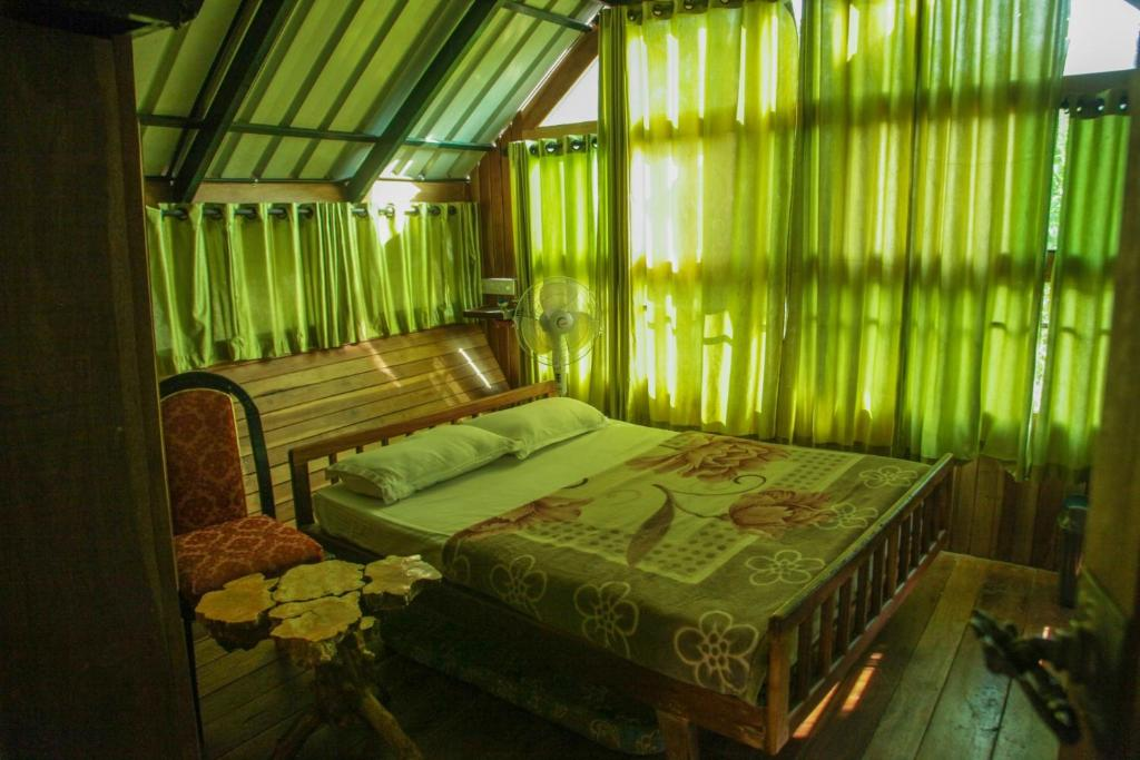 Tree house with a green view in wayanad by guesthouser - House with a view ...