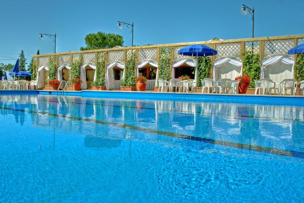 The swimming pool at or near Fattoria La Principina Hotel