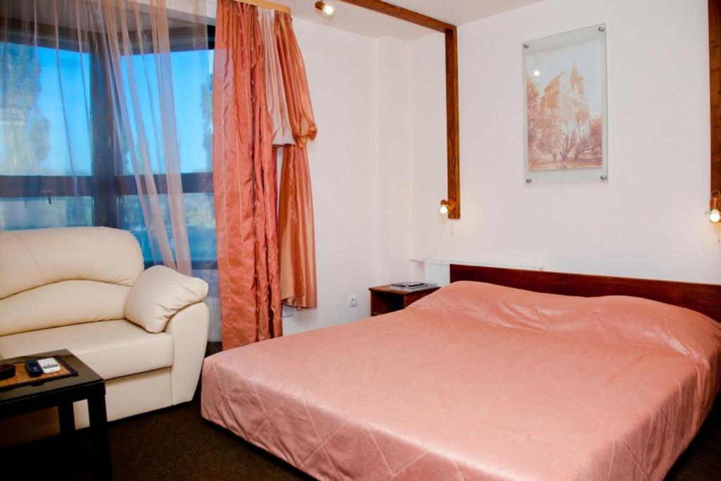 Кровать или кровати в номере Гостиница Бремен