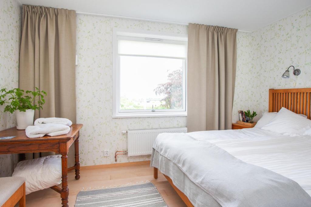 Postel nebo postele na pokoji v ubytování Gränna Lakeview