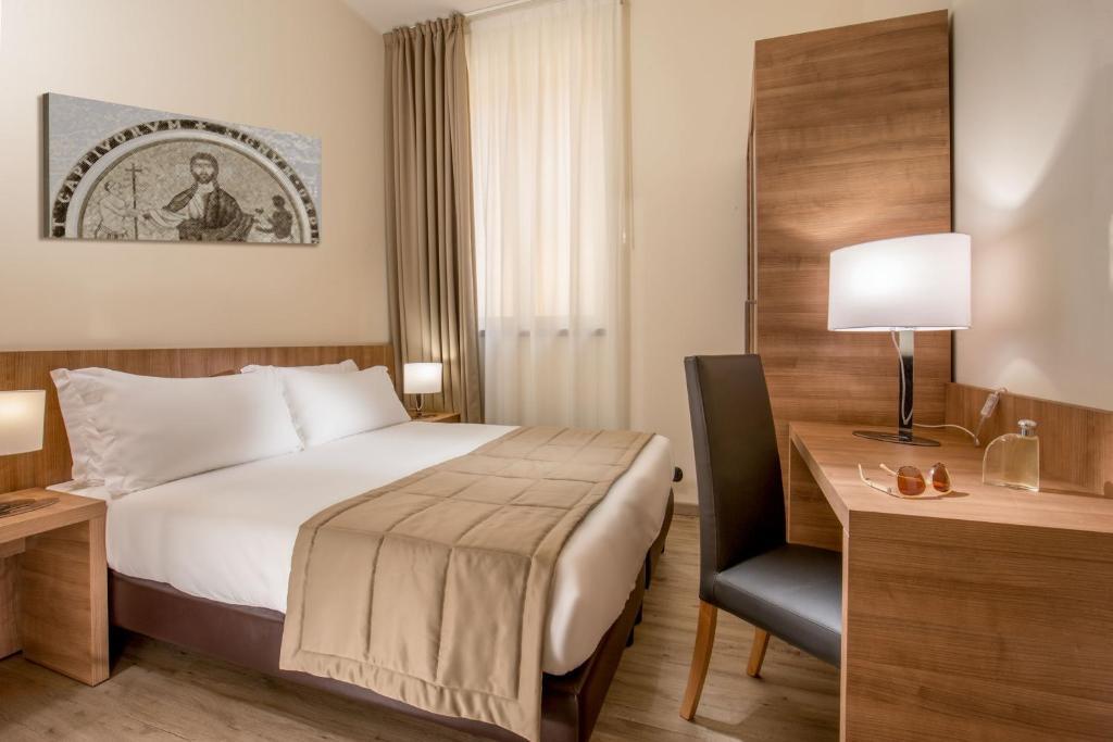 Tempat tidur dalam kamar di Casa Santa Maria Alle Fornaci
