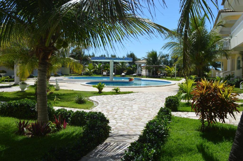 The swimming pool at or near Apartamento Luxuoso em Canoa Quebrada