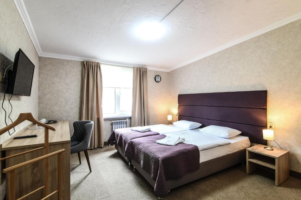 Кровать или кровати в номере Отель Авиатор Шереметьево