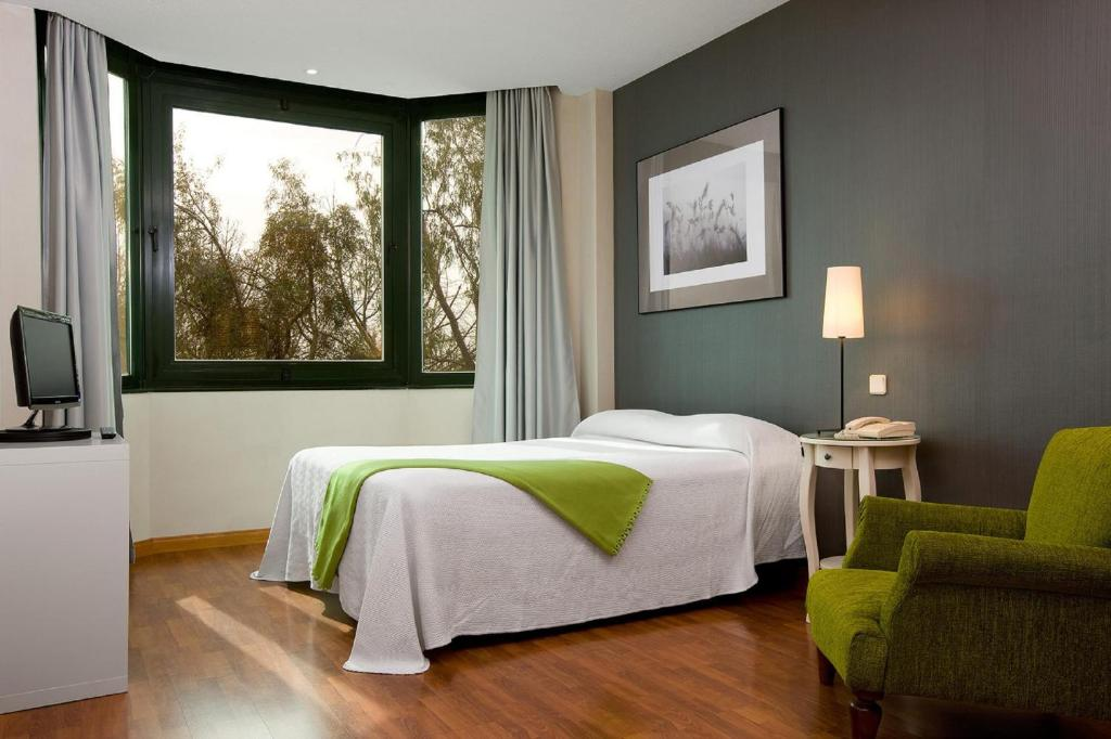 A bed or beds in a room at TH Las Rozas