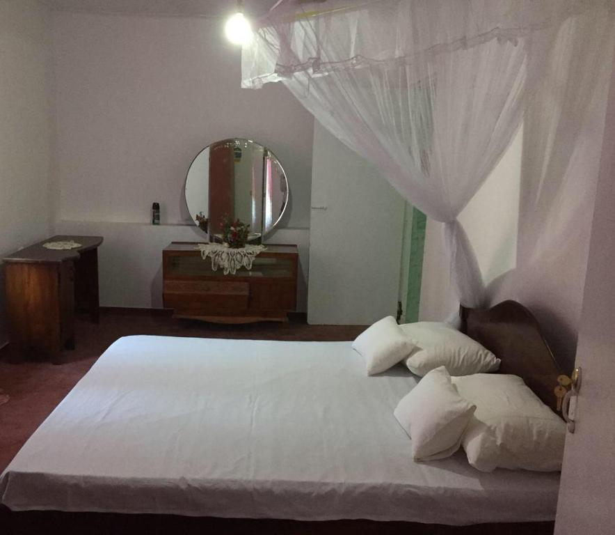 A bed or beds in a room at villa eleven