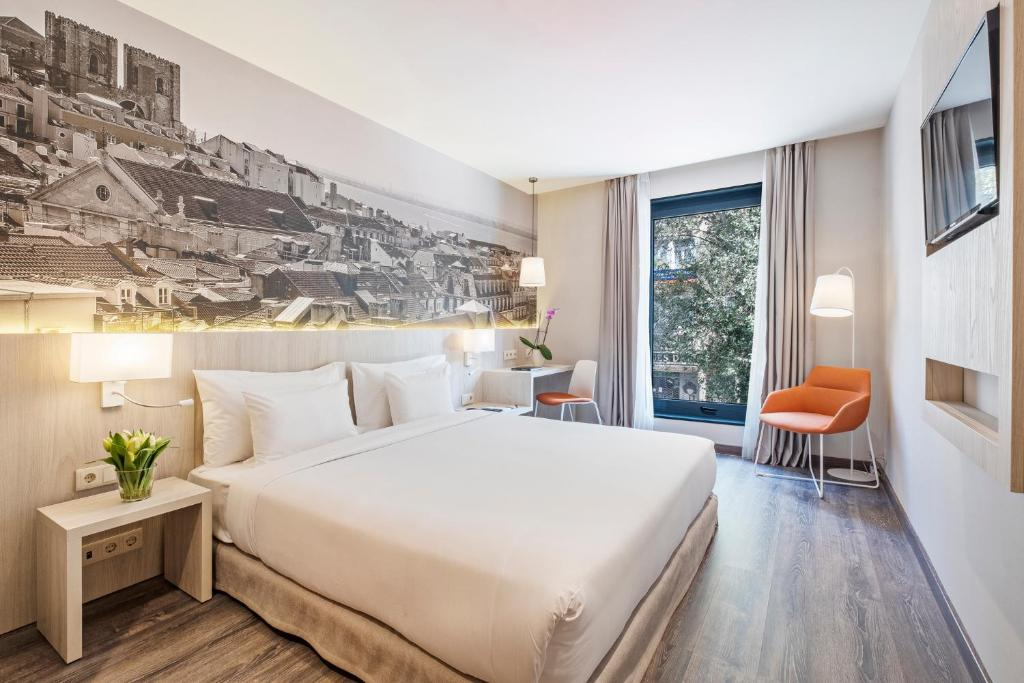 A bed or beds in a room at EXE Liberdade