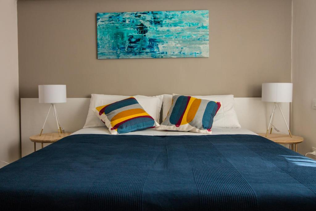 A bed or beds in a room at Le Torri B&b Apartments