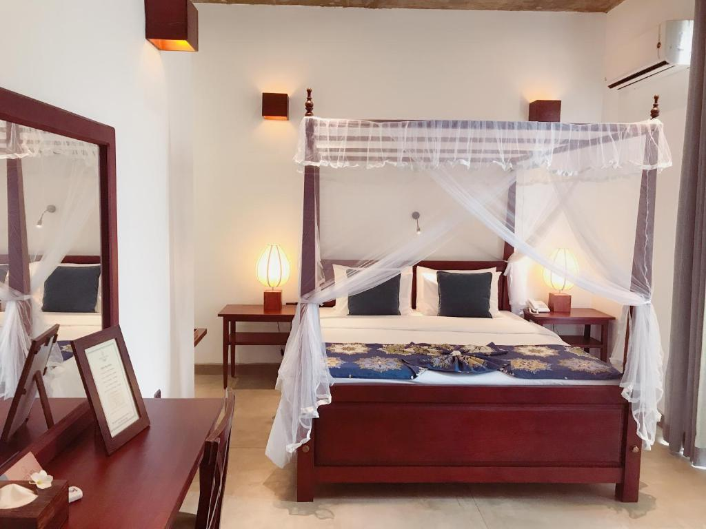A bed or beds in a room at Coza Ceylon