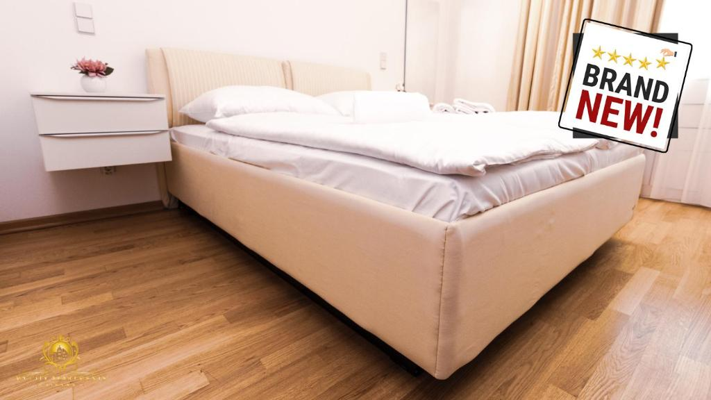 A bed or beds in a room at My City Apartments - 5 Star Apartment in the 1st District