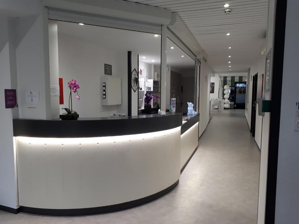 The lobby or reception area at Hôtel Le Président
