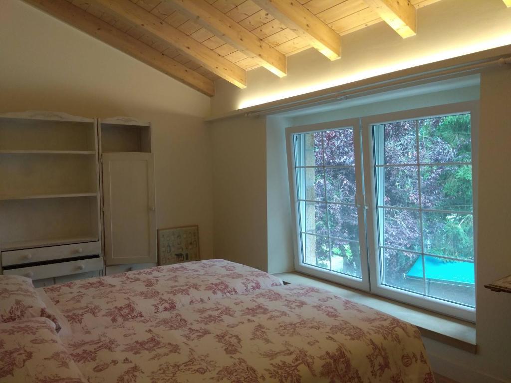 A bed or beds in a room at La Bicicleta Casa Rural