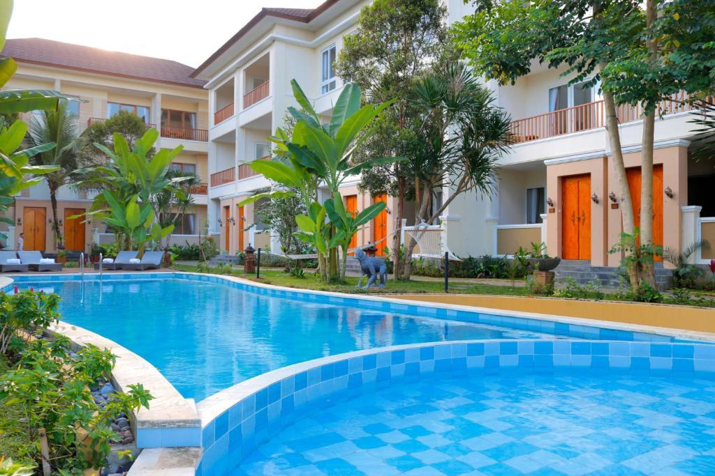 The swimming pool at or near Ashoka Tree Resort at Tanggayuda