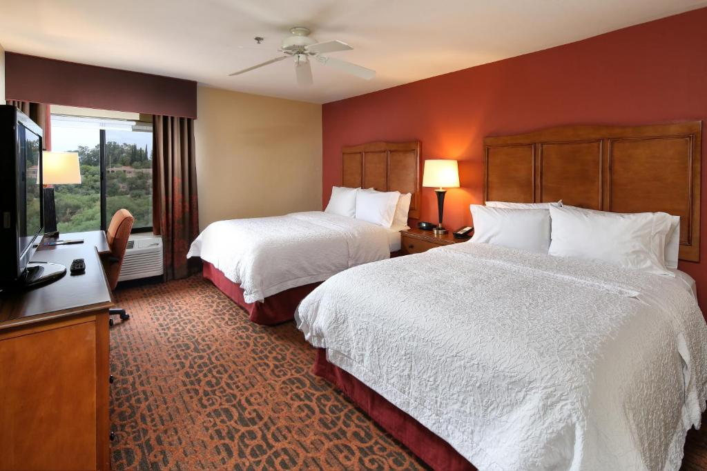 A bed or beds in a room at Hampton Inn & Suites Tucson Mall