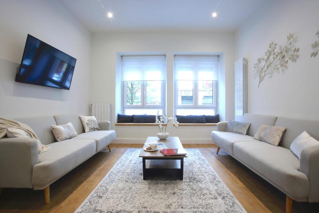 A seating area at Prim Suite Apartment