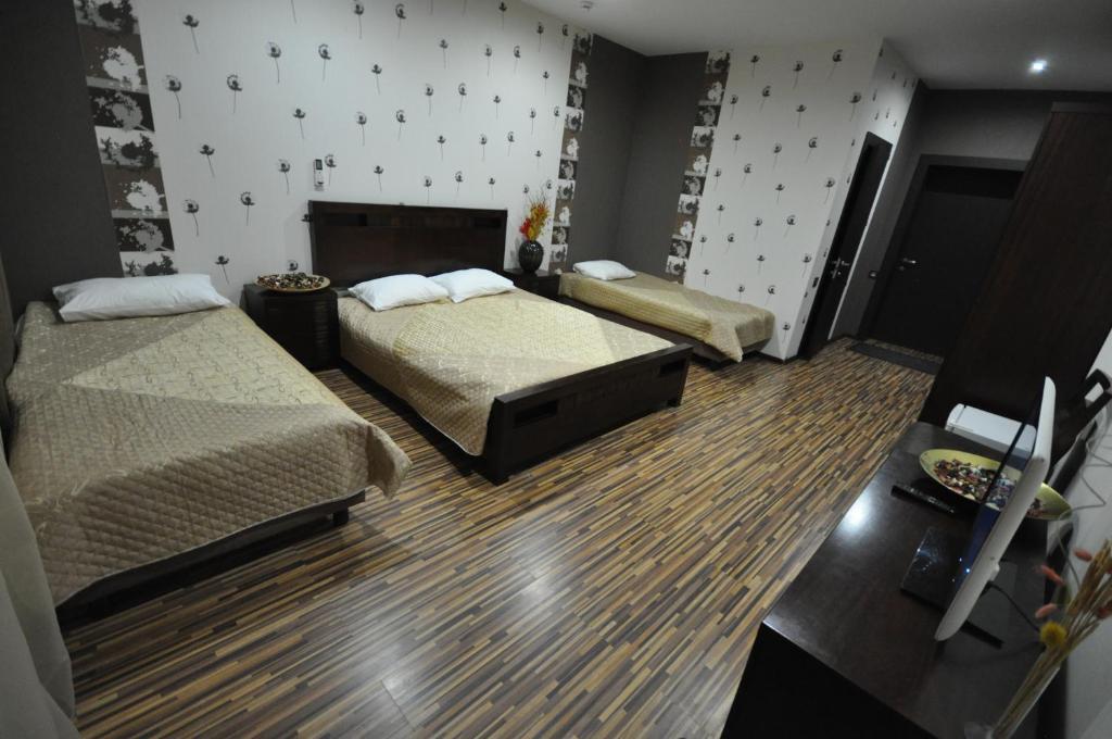 Кровать или кровати в номере Вилла Вита