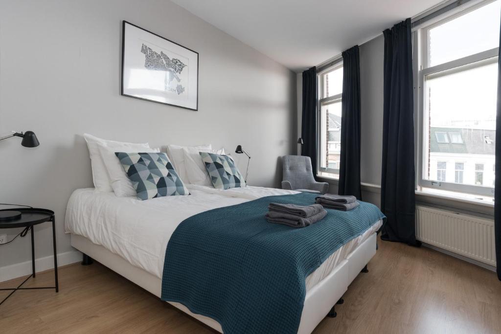 Ένα ή περισσότερα κρεβάτια σε δωμάτιο στο Museum District Studio's