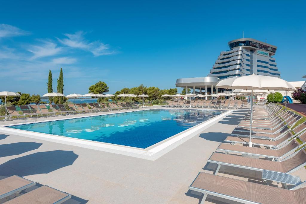 The swimming pool at or near Hotel Olympia Sky