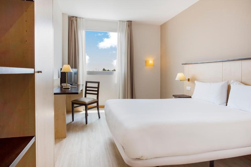 A bed or beds in a room at B&B Hotel Madrid Pinar de las Rozas