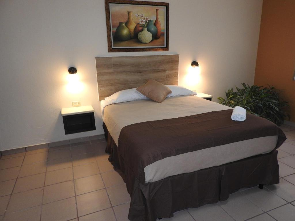 A bed or beds in a room at Dreams Miramar