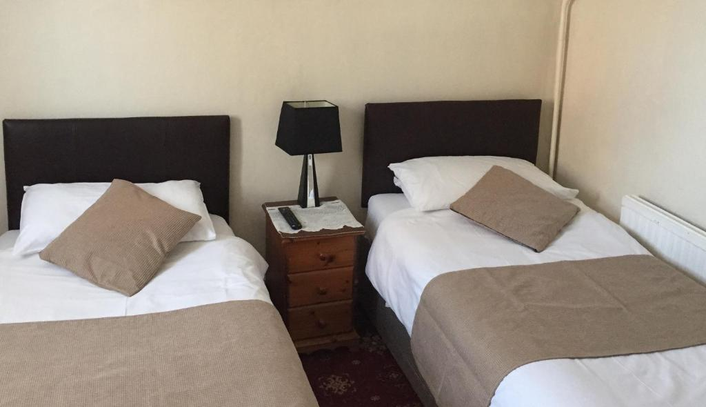 A bed or beds in a room at Maranatha Guest House
