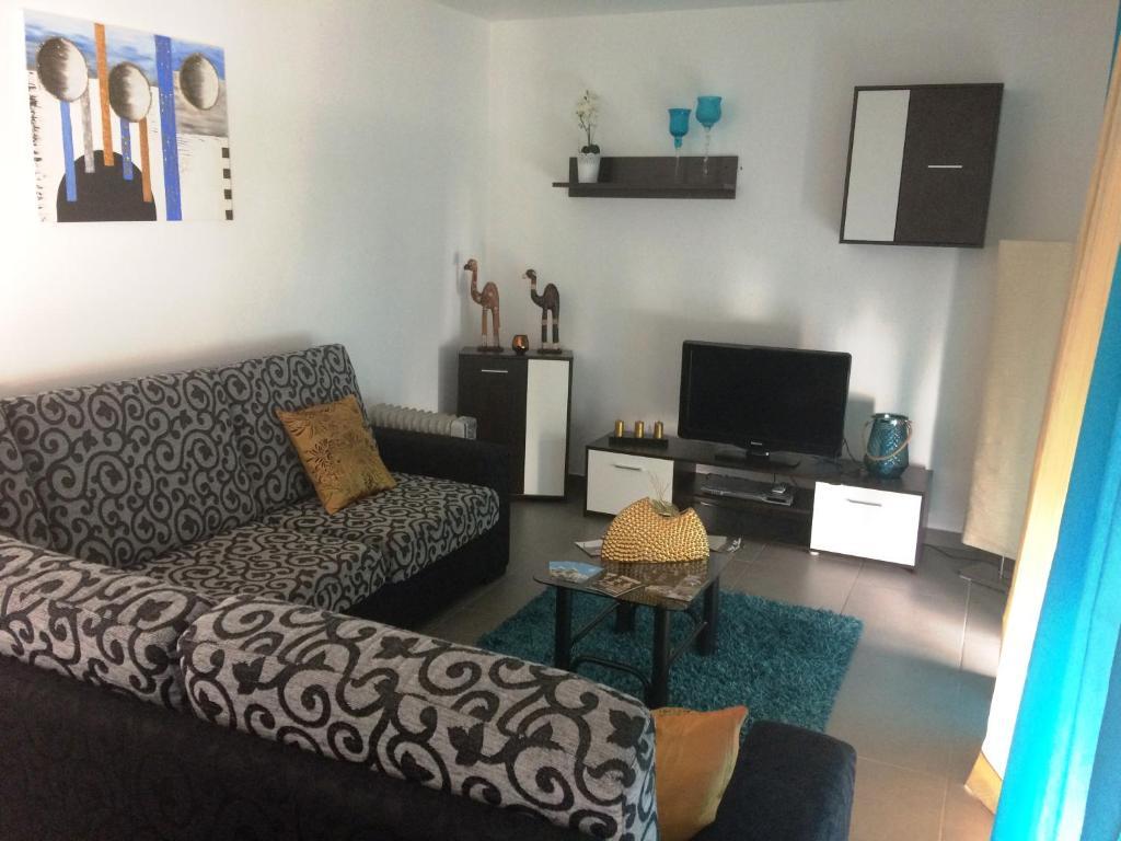 """A seating area at Apartamento """"Irmãos Vergueiro"""""""