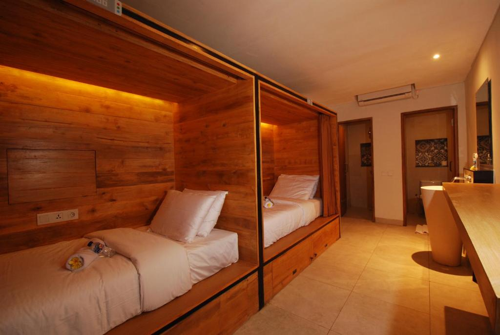 A bed or beds in a room at Beds Hostel By Soscomma
