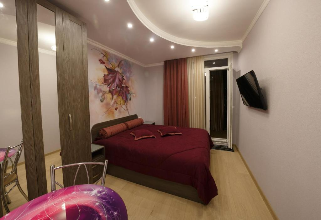 Кровать или кровати в номере Seasons Hostel