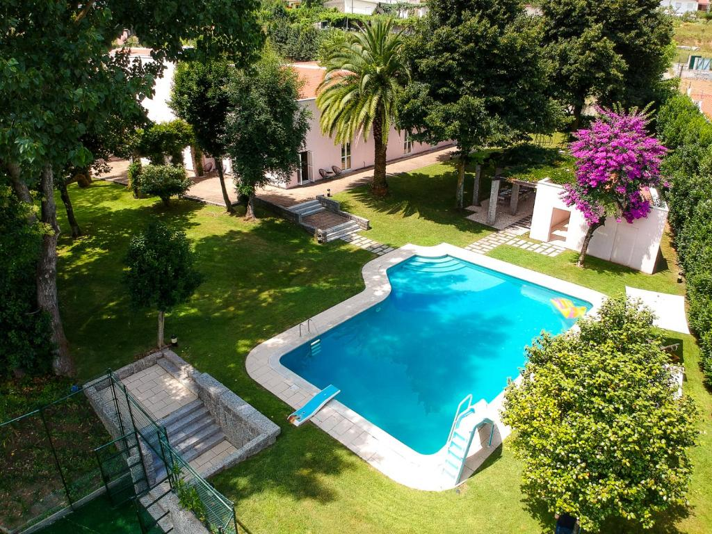 A view of the pool at Casa da Cachada or nearby