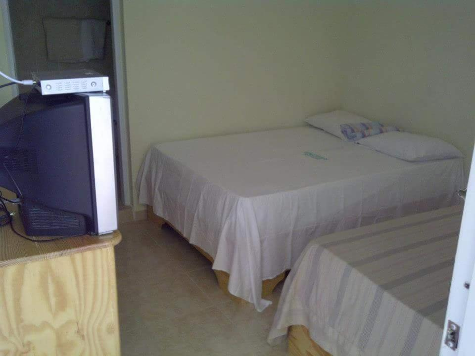 A bed or beds in a room at Hostal Adelaida