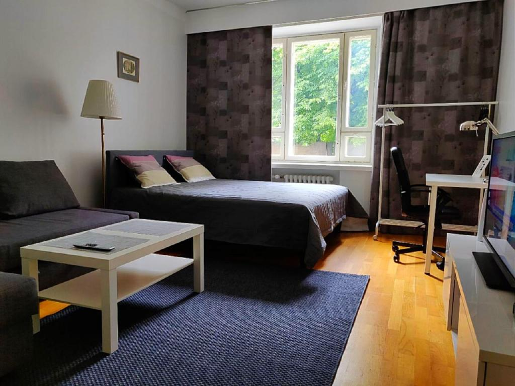 A bed or beds in a room at Spacious apartment DIANA in Helsinki city center