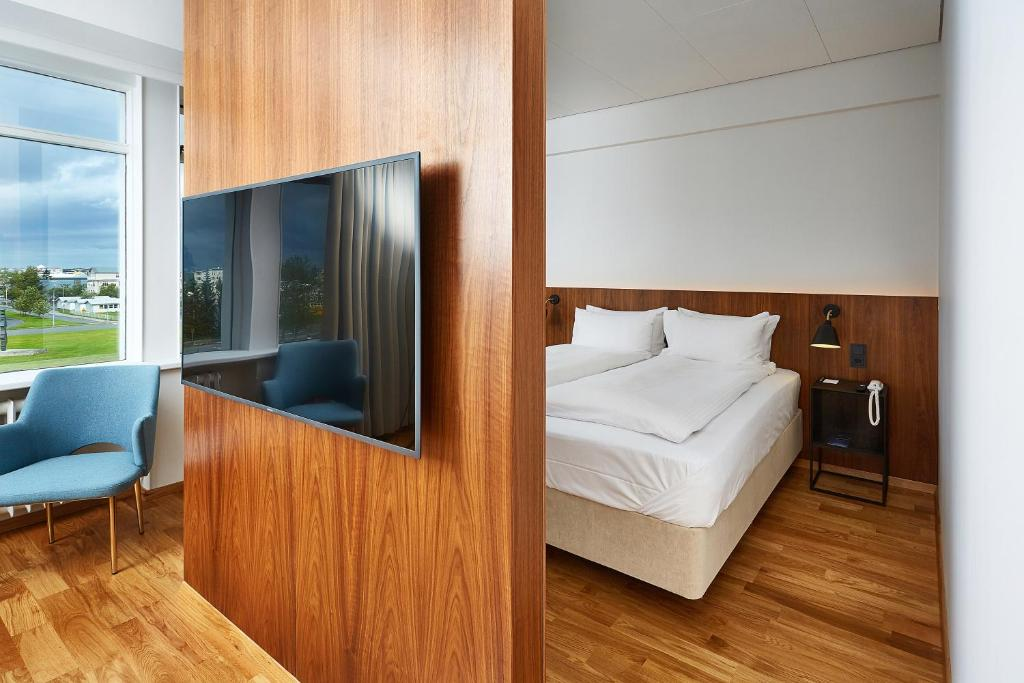 A bed or beds in a room at Radisson Blu Saga Hotel, Reykjavík