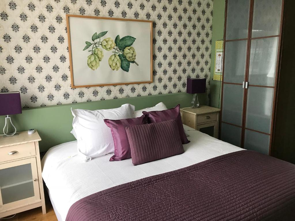 A bed or beds in a room at Blaine's: A B&B and private dining....
