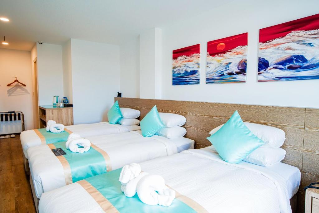 Postel nebo postele na pokoji v ubytování Palau Hotel