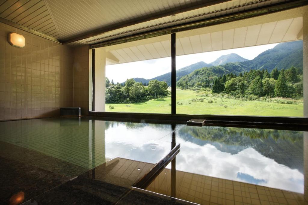 The swimming pool at or close to Kyukamura Myoko