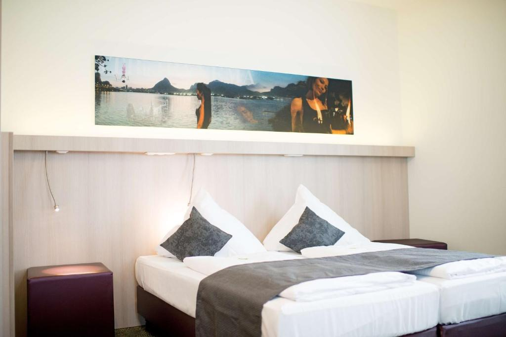A bed or beds in a room at Best Western Hotel Bad Rappenau