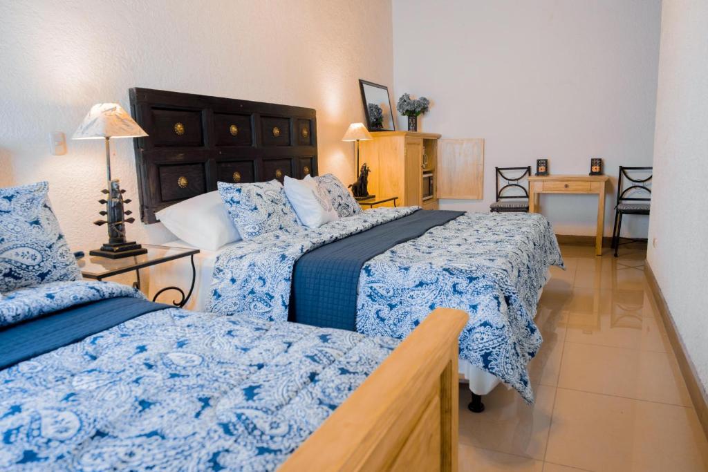 Cama o camas de una habitación en Hotel Apartment La Capitanía