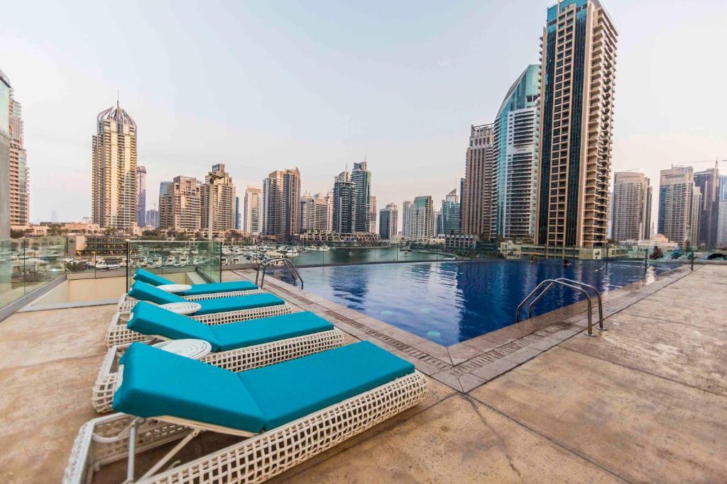 Bravoway cayan tower in dubai marina 4202 dubai - Dubai airport swimming pool price ...