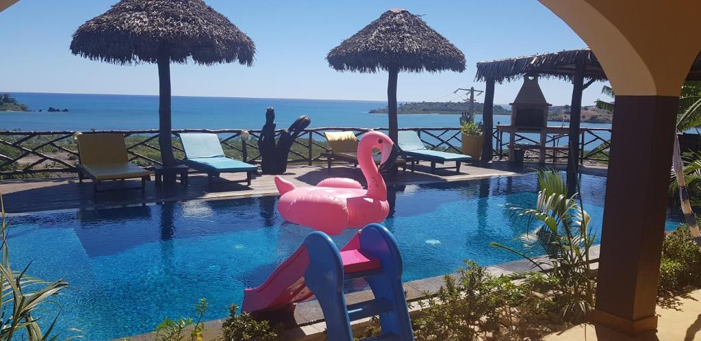 The swimming pool at or near villa nosy détente