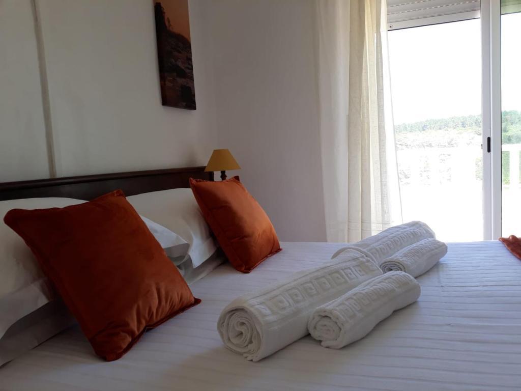 A bed or beds in a room at Casa Dorita