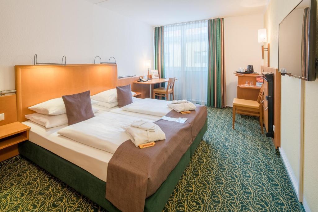 En eller flere senger på et rom på Best Western Hotel München Airport