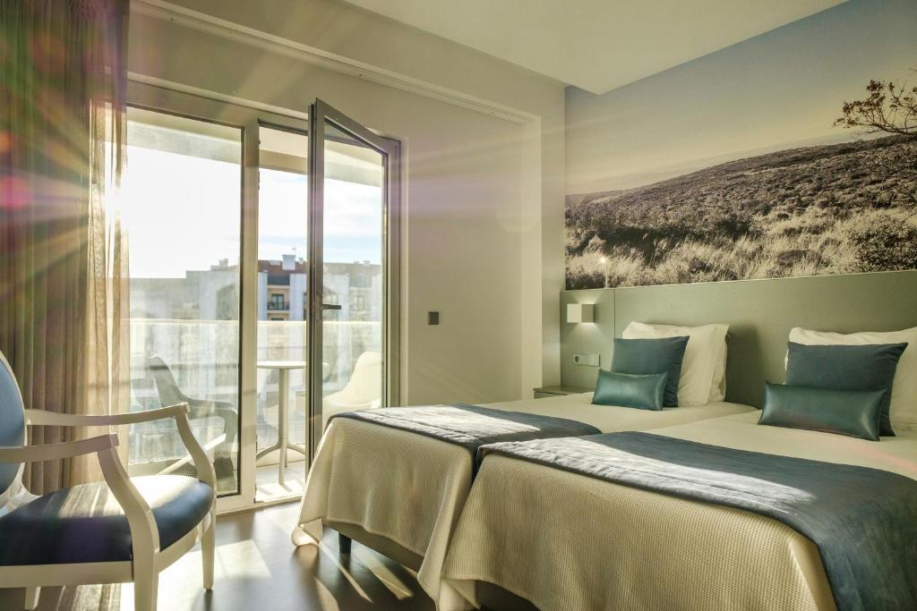 A bed or beds in a room at Hotel Serra d`Aire