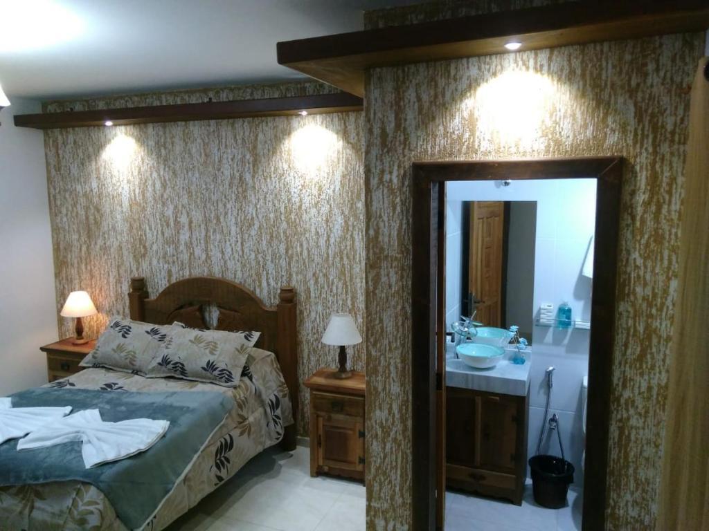 Łóżko lub łóżka w pokoju w obiekcie Mina do Capote