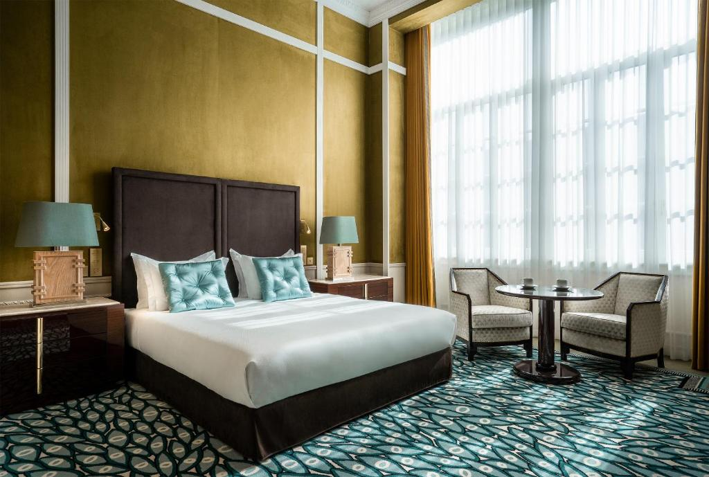 Säng eller sängar i ett rum på Maison Albar Hotels Le Monumental Palace