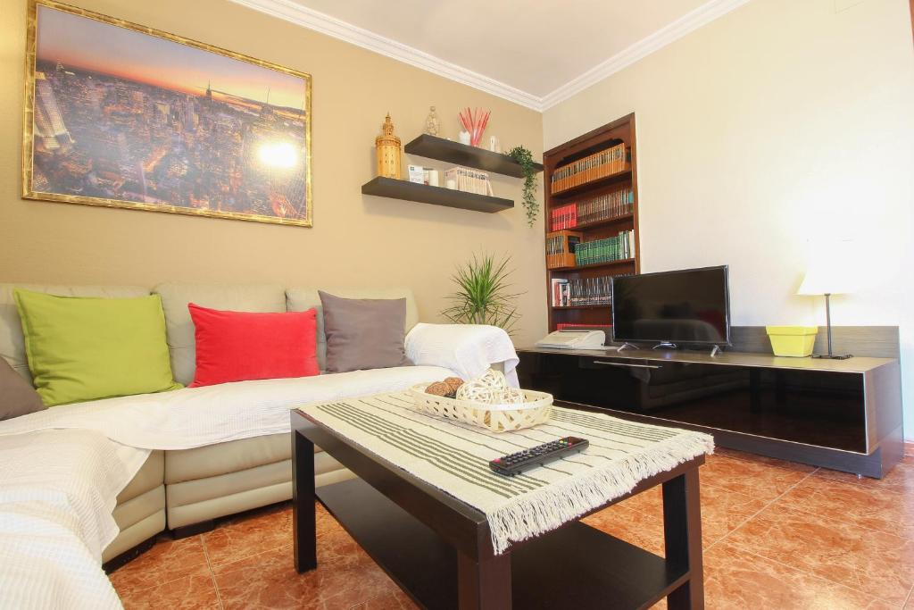 A seating area at Beautiful family apartment in Sevilla