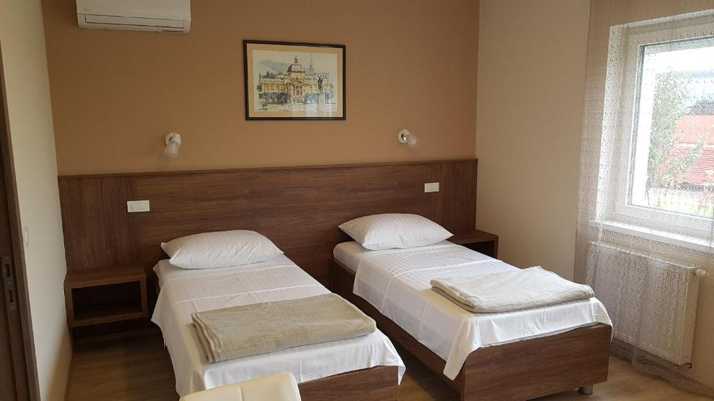 A bed or beds in a room at Rooms Pleška near Zagreb Airport