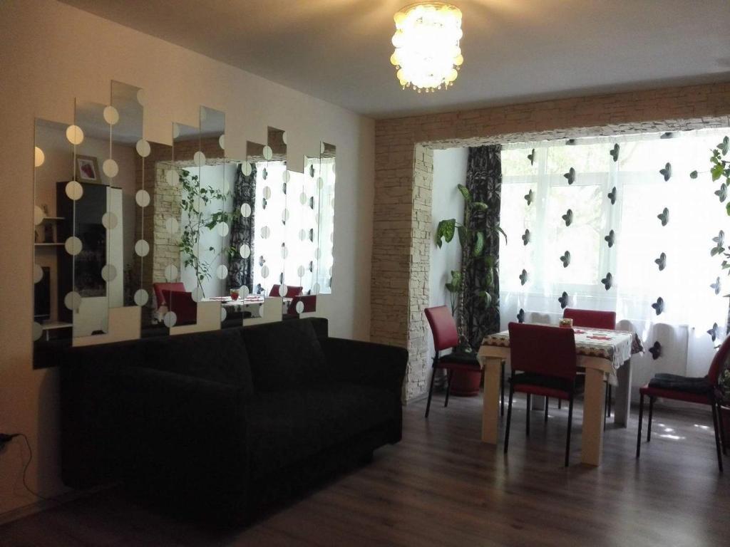 A seating area at Apartament Ela Elegance