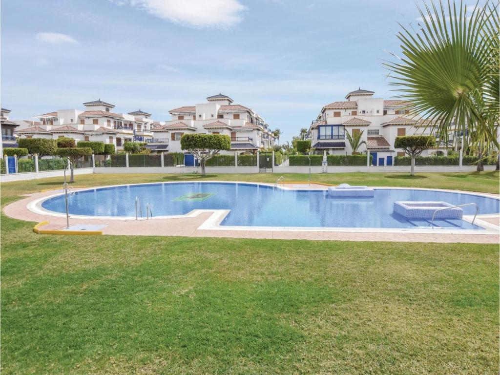 The swimming pool at or near Two-Bedroom Holiday Home in Vera