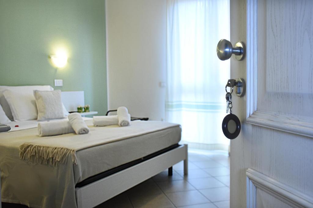 Letto o letti in una camera di Hotel Stella D'Oro